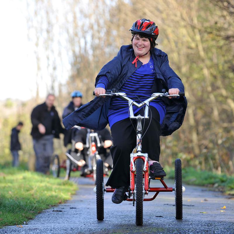 Girl cycling on trike