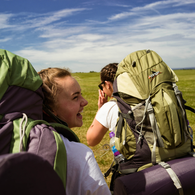 Two female participant on expedition wearing rucksacks